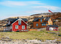 Norwegian village with colorful wooden houses on rocky sea coast Royalty Free Stock Photo