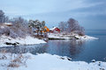 Norwegian winter fjord landscape with colorful houses two Stock Photo