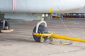 Nose landing gear and tow bar. Royalty Free Stock Photo