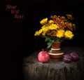 Nosegay of chrysanthemums and gayllardiyas with ripe fruits still life in country style mysterious night time lighting vivid Royalty Free Stock Photography