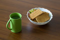 Nosh light water and cookies food at the background of wood Royalty Free Stock Photo