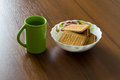 Nosh light water and cookies food at the background of wood Royalty Free Stock Photography