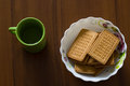 Nosh light water and cookies food at the background of wood Stock Photos
