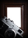 Nostalgia art and photography vintage silver camera isolated wooden border Stock Image