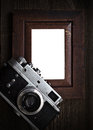 Nostalgia art and photography vintage silver camera isolated wooden border Stock Photo