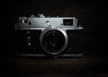 Nostalgia art and photography vintage silver camera on wooden background Royalty Free Stock Image