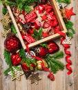 Nostalgic Christmas decoration red stars baubles ribbons ornamen Royalty Free Stock Photo