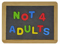 Not for adults in colored letters on slate written traditional Stock Photography