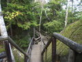 Not for the faint of heart wooden walkways pass through glacier made cracks crevices and cave in mountains new hampshire Royalty Free Stock Photography