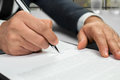 Notary's hands doing daytime paperwork. Royalty Free Stock Photo