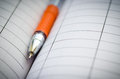 Note book and pen ballpoint ink on a spiral bound journal ready for writing Royalty Free Stock Image