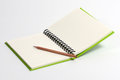 Note book pencil ready to write somthing note book green cover was open page have lines write Royalty Free Stock Photography