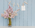 Note on the clothespin and bunch of lilac romantic table blue wooden background Royalty Free Stock Photo