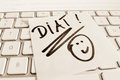 Note on computer keyboard diet a sticky is the of a as a reminder Stock Image