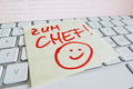 Note on computer keyboard go to boss a sticky is the of a as a reminder for chief Royalty Free Stock Image