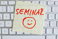 Note on computer keyboard seminar a sticky is the of a as a reminder Royalty Free Stock Image