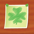 Note with four leaf shamrock pinned to wooden board Royalty Free Stock Images