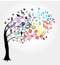 Note illustration of a tree with colorful music notes and birds Royalty Free Stock Images