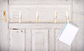 Note pad hanging from a clothes line with an antique wooden background Royalty Free Stock Photo