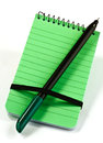 Note pad and pen a green book felt tip Royalty Free Stock Images