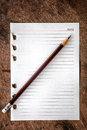 Note pad with pencil on wooden background Royalty Free Stock Photo