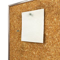 Note pad and push pin isolated on cork board ready for your text Stock Photo