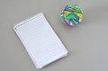 Note Pad with Rubber Band Ball Royalty Free Stock Photo