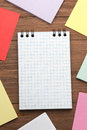 Note paper and checked notepad on wood background Royalty Free Stock Photography