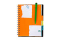 Note paper and orange notebook with green pen isolated on white background Royalty Free Stock Images
