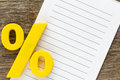 Note paper with percentage sign yellow plastic Royalty Free Stock Image