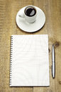 Note, pen and cup of coffee Stock Photos