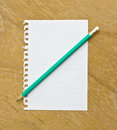 Note and pencil on wooden board Royalty Free Stock Image