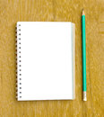 Note and pencil on wooden board Stock Image