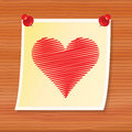 Note with valentine pinned to wooden board Stock Photo