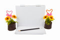 Notebook and Artificial Sunflower on white Royalty Free Stock Photo