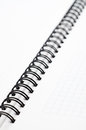 Notebook with black wire closeup of Royalty Free Stock Photos