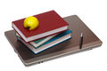 Notebook books and half an apple on the notebook Royalty Free Stock Images
