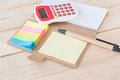 Notebook, Calculator, on wood background. Royalty Free Stock Photo