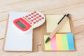 Notebook, Calculator, On Wood Background, Selective Focus. Royalty Free Stock Photo