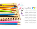 Notebook and color pencils stationery isolated on white background Stock Photography