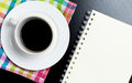 Notebook copy space with Coffee cup on colorful fabric Royalty Free Stock Photo