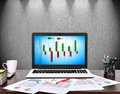 Notebook with cost chart on screen business concept Royalty Free Stock Images
