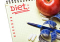 Notebook diet plan measuring tape pills Stock Photo