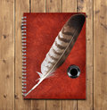 Notebook and feather with ink bottle Royalty Free Stock Photo