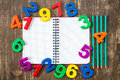Notebook with four pencils and colored numbers Royalty Free Stock Photo
