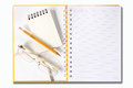 Notebook glasses and yellow pencil on white Stock Photos