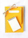 Notebook glasses and yellow pencil on white Stock Images