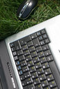 Notebook on green grass Royalty Free Stock Photos