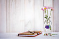 Notebook or journal with pen of flowers.