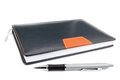 Notebook office organizer and funky ballpoint pen on a white background Stock Photo